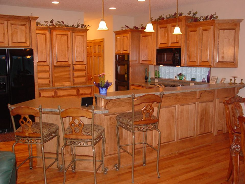how much more do custom kitchen cabinets cost